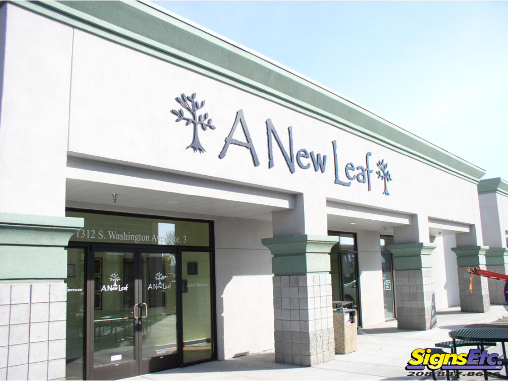 new leaf store front sign